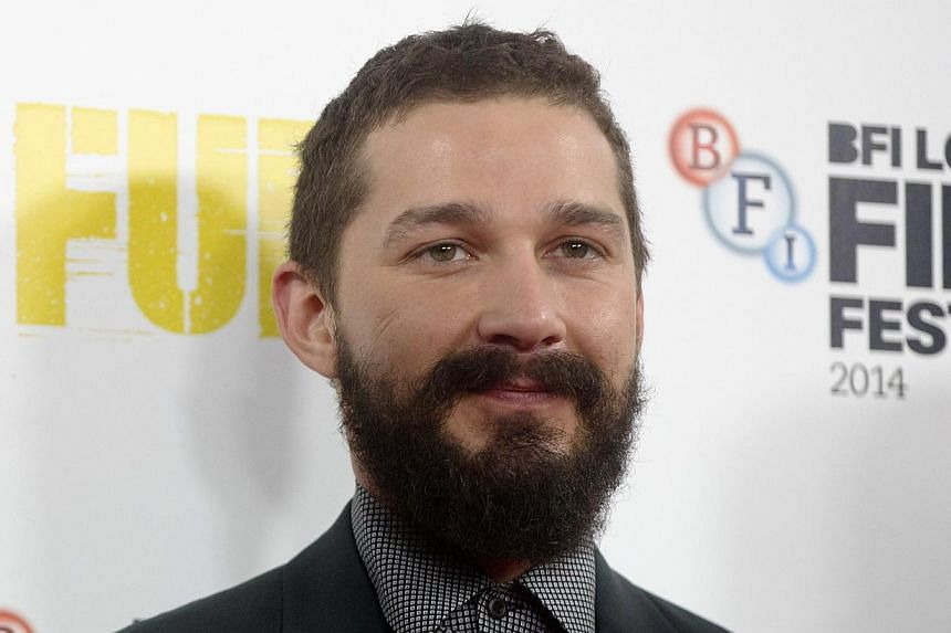 Actor Shia LaBeouf poses during a photocall for his film Fury in London on Oct 19, 2014. -- PHOTO: REUTERS