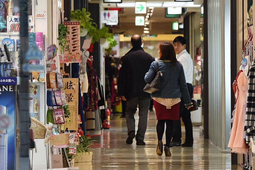 People strolling in a shopping mall in Tokyo. Japan's fall into recession between July-September could turn out to be less severe than feared, with new capital expenditure figures out on Monday suggesting revisions will put third quarter economic gro
