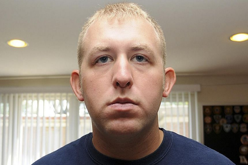 Mr Darren Wilson, who said he was acting in self-defence and that his conscience is clear, had been on administrative leave and in seclusion since the incident. -- PHOTO: REUTERS