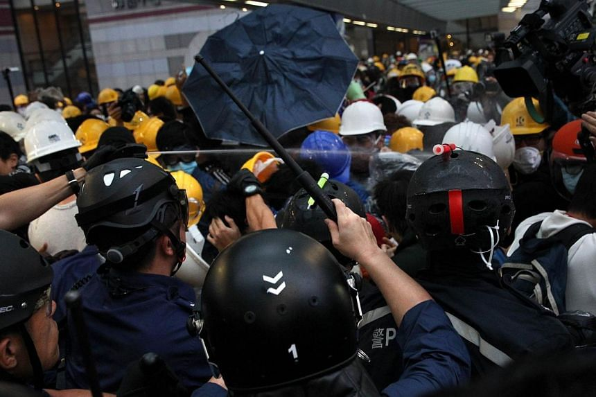 """Police use pepper spray against pro-democracy protesters near the government headquarters in the Admiralty district of Hong Kong on Dec 1, 2014.Hong Kong Chief Executive Leung Chun Yingsaid on Monday that pro-democracy protests were """"in v"""