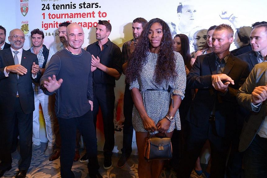 Tennis stars and lengends, among them Andre Agassi (front, left) and Serena Williams (front, right) at a private party held by DBS ahead of the kick-off of the Singapore leg of the IPTL at Shangri-La Hotel. -- ST PHOTO: DESMOND WEE
