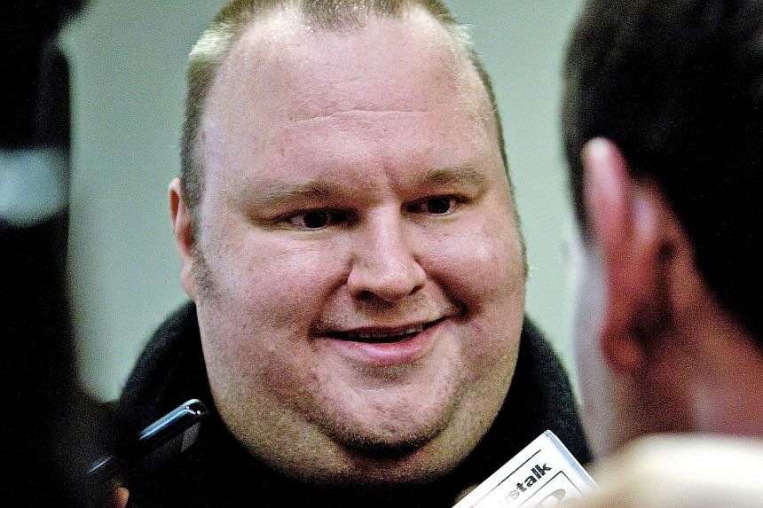 A file photo taken on July 3, 2013, shows Megaupload founder Kim Dotcom speaking to the media in Wellington. United States authorities have lost a motion to have cyber fugitive Kim Dotcom remanded in custody in New Zealand before his extradition
