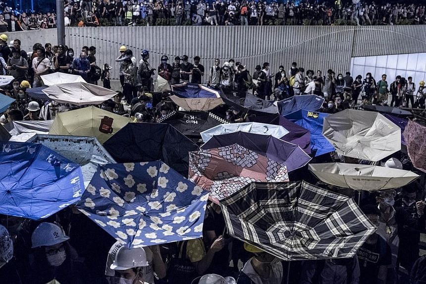 Pro-democracy protesters gather at Tamar, near the government headquarters in the Admiralty district of Hong Kong on Dec 1, 2014. Hong Kong's pro-democracy protests are now into the third month. With frustrations mounting, Chief Executive Leung