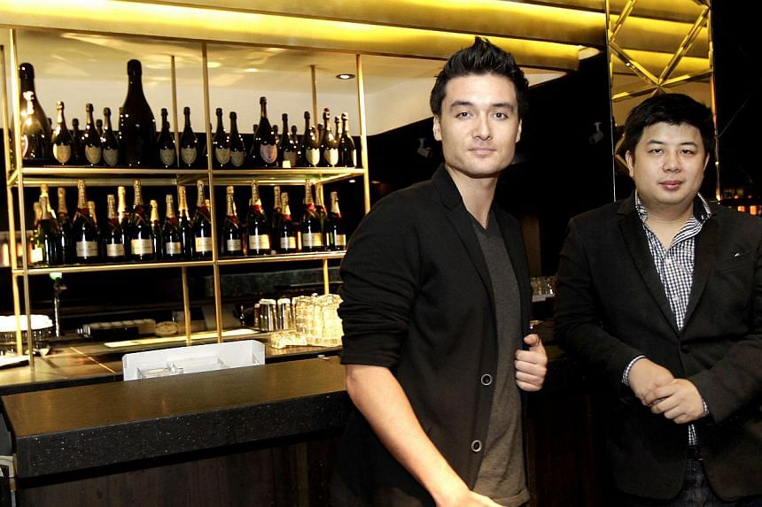 Mr John Langan (left) with Mr Phillip Poon, his business partner in lifestyle group Massive Collective; and during his early clubbing days in Singapore with a friend. -- PHOTO: ST FILE