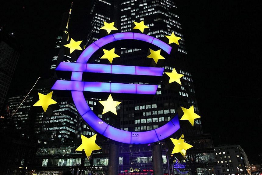 An illuminated euro sign in front of the European Central Bank (ECB) in Frankfurt, western Germany.-- PHOTO: AFP