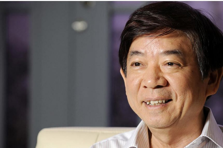 Pro-family housing policies proved popular with flat buyers in the latest Housing Board flat launch, said National Development Minister Khaw Boon Wan. -- PHOTO: BLOOMBERG