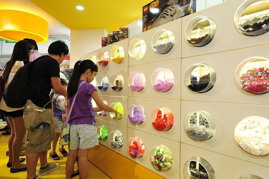 At Singapore's first Lego Certified Store, shoppers can pick the bricks they want at the Pick-a-Brick wall. -- ST PHOTO: DIOS VINCOY JR