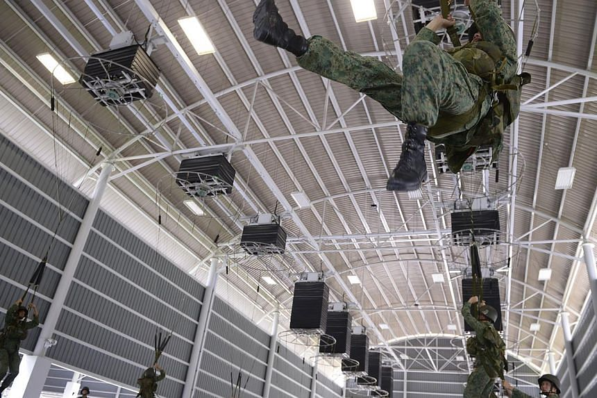 NSF commandos from the 1st Commando Battalion train with Rotational Trainer System (RTS) apparatus at the Parachuting Training Facility (PTF) at the new Singapore Armed Forces (SAF) Airborne-Tropper Training Facility (ATF) during a media preview on N