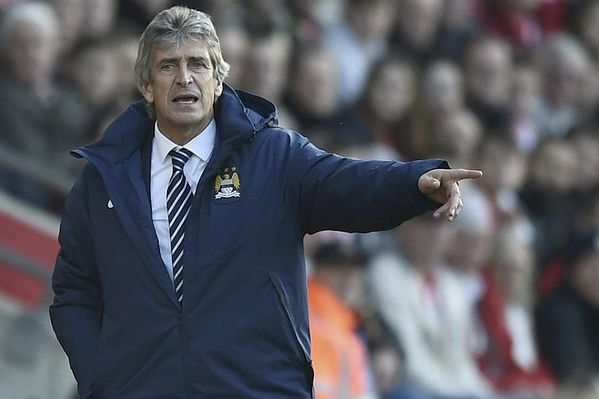 Manchester City manager Manuel Pellegrini gestures during their English Premier League soccer match against Southampton at St Mary's Stadium in Southampton on Nov 30, 2014. -- PHOTO: REUTERS