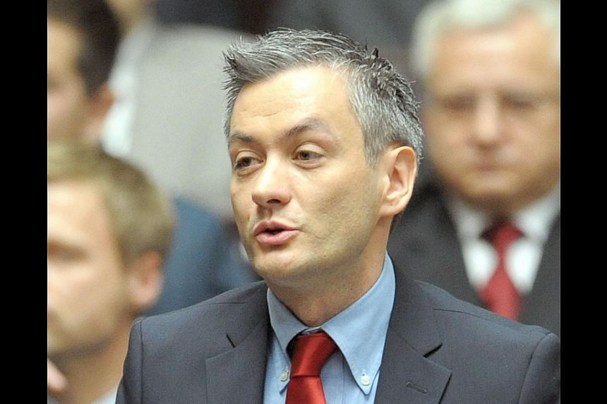 Poland's first openly gay lawmaker, Robert Biedron, in a photo taken on Nov 8,2011 during a session of the Polish Parliament in Warsaw. On Sunday, Polish voters elected him their first openly gay mayor as the heavily Catholic country gradually shifts