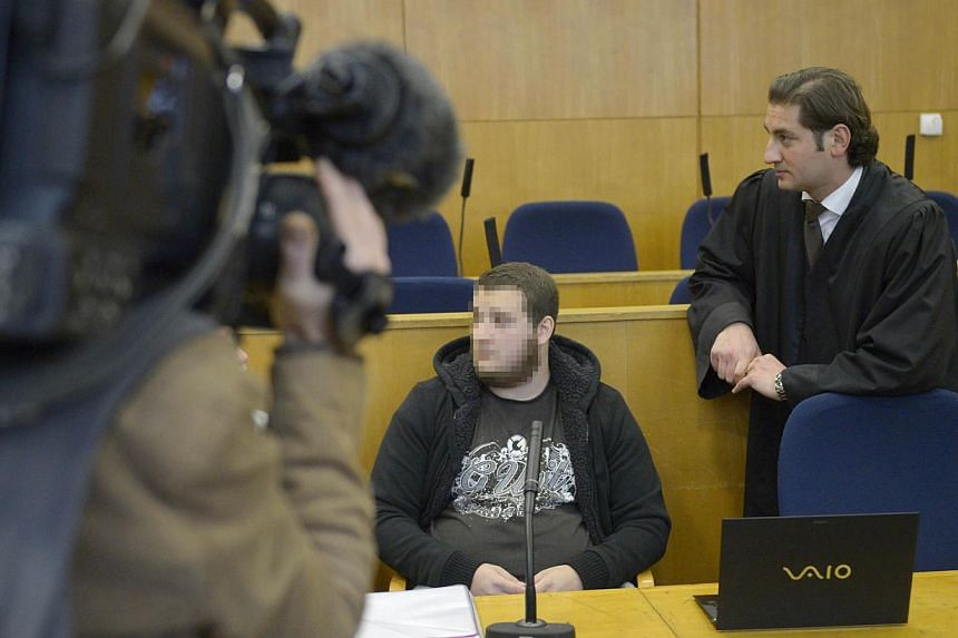 Alleged Kreshnik B (centre) next to his lawyer Mutlu Guenal (left) at the higher regional court in Frankfurt am Main, western Germany, on the opening of his trial on charges of fighting for ISIS (Islamic State in Iraq and Syria) in a photo taken on S