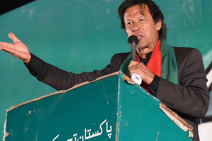 Pakistani cricketer-turned-opposition leaderImran Khan tells tens of thousands of supporters near parliament in Islamabad on Sunday evening that his party workers would paralyse major cities with protests starting on Dec 16. -- PHOTO: AFP