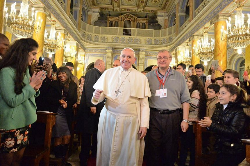 Pope Francis meeting with Iraqi refugees in Instanbul on Nov 30, 2014 as part of his three days visit in Turkey, in a handout photo released by the Vatican press officel. -- PHOTO: AFP