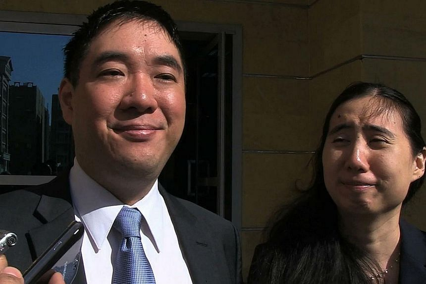 Matthew (left) and Grace Huang, a US couple charged with parental neglect leading to the death of their adopted daughter, talk to journalists after being acquitted by a Qatari appeals court on Nov 30, 2014 in Doha. Matthew and Grace Huang were arrest