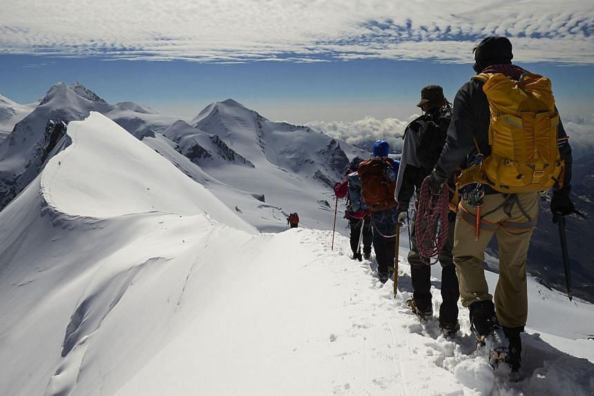 Roped up climbers leave the summit of Breithorn at 4,164 metres on the ridge marking the border with Switzerland (left) and Italy in the Alpine resort of Zermatt in August.On Suynday, Swiss voters overwhelming rejected the so-called Ecopop refe