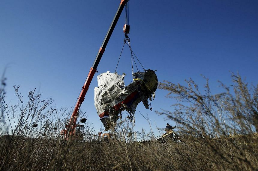 Wreckage of Malaysia Airlines flight MH17 recovered from its crash site in eastern Ukraine will be reassembled for an investigation at a military base in the Netherlands, Dutch authorities said on Monday. -- PHOTO: REUTERS