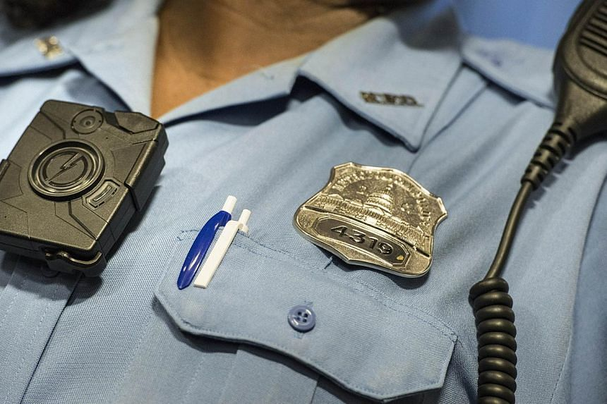 Police Officer Debra Domino models a body camera before a press conference at City Hall in Washington, DC on Sept 24, 2014 . US President Barack Obama has asked Congress for US$263 million (S$343 million) for the federal response to the civil rights