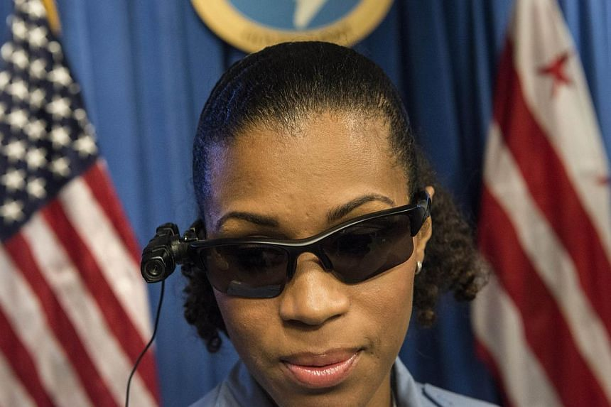 Police Officer JaShawn Colkley models an eye level body camera before a press conference at City Hall in Washington, DC on Sept 24, 2014 . US President Barack Obama has asked Congress for US$263 million (S$343 million) for the federal response to the