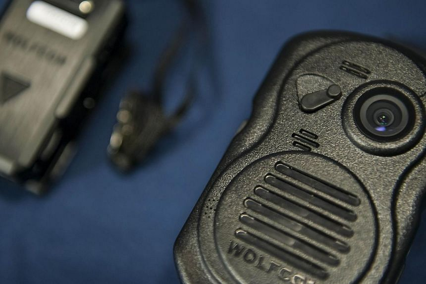 A combination body camera radio microphone is seen during a press conference at City Hall in Washington, DC on Sept 24, 2014 . US President Barack Obama has asked Congress for US$263 million (S$343 million) for the federal response to the civil right