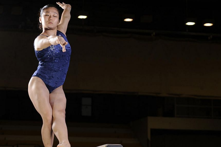 Gymnast Lim Heem Wei training on the balance beam at the Bishan Sports Hall on April 16, 2012.-- PHOTO: ST FILE