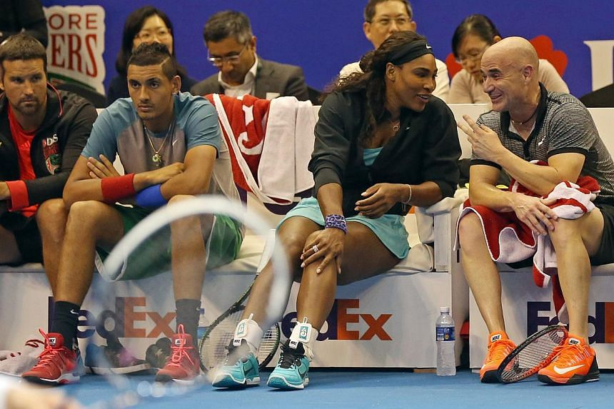 Opening day of the Singapore leg of the International Premier Tennis League (IPTL). DBS Singapoer Slammers Andre Agassi and Serena Williams at the sidelines. -- ST PHOTO: SEAH KWANG PENG