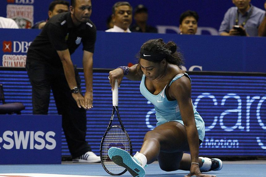 Singapore Slammers' Serena Williams of the U.S. recovers after chasing a return from Manila Mavericks' Kirsten Flipkens of Belgium during their women's singles match at the International Premier Tennis League (IPTL) in Singapore on Dec 2, 2014. -- PH