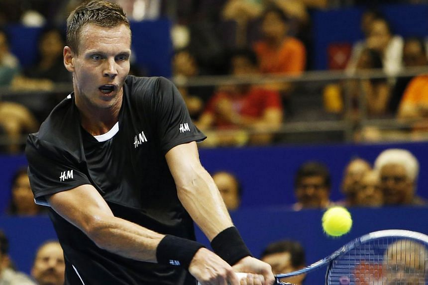 Singapore Slammers' Tomas Berdych of the Czech Republic hits a return to Manila Mavericks' Jo-Wilfried Tsonga of France during their men's singles match at the International Premier Tennis League (IPTL) in Singapore on Dec 2, 2014. -- PHOTO: REUTERS