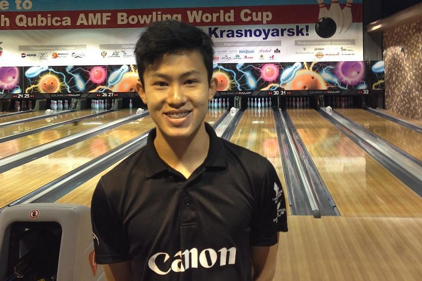 National bowler Joel Tan at the QubicaAMF Bowling World Cup in Krasnoyarsk in Russia in 2013.He was in top form as he notched four 300-pinfall games yesterday, two in qualifying, one in the Masters and another in the step ladder finals at the 1