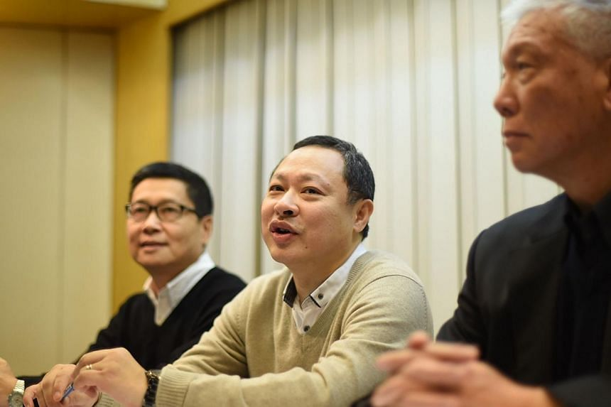Pro-democracy activist Benny Tai (centre) attends a press conference with fellow activists Chan Kin-man (left) and Chu Yiu-ming (right) in Hong Kong on Dec 2, 2014. -- PHOTO: AFP