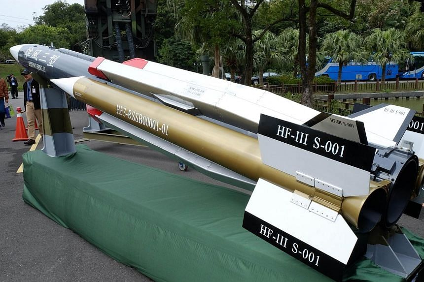 Local journalists look at a model of Hsiungfeng III missile at The Chungshan Institute of Science and Technology in Lungtan district of Taoyuan city on Dec 2, 2014. Taiwan arms developers said Tuesday that new surface-to-air missiles would defend its