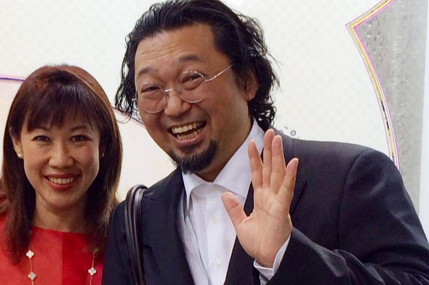 Lawyer-gallerist Valerie Cheah and Japanese Pop artist Takashi Murakami at Art Basel in Hong Kong this year. -- PHOTO: VALERIE CHEAH