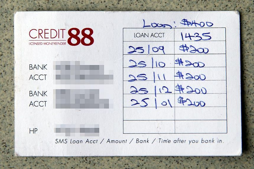 Mr Goh Chin Ann (right) borrowed $400, but his repayment card (above) shows the repayment amount has snowballed to $1,000.