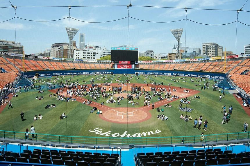 People taking part in a large-scale escape game at a stadium in Yokohama, Japan. They were locked up and had to solve puzzles against the clock to break out. Only 120 out of 1,600 participants made it through in the game's first edition. A local vers