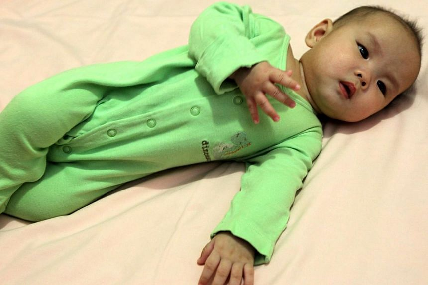 A posed photo of a baby lying on her side. More than half of infants in the United States are being placed to sleep with bedding that puts them at greater risk of sudden infant death syndrome (SIDS), researchers warned in a report on Monday. -- PHOTO
