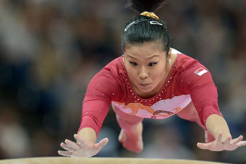 Singapore's gymnast Lim Heem Wei competing on the vault during the women's artistic gymnastics qualification at the London Olympics on July 29, 2012. Lim Heem Wei announced her retirement from the national team on Dec 2, 2014. -- ST PHOTO:M