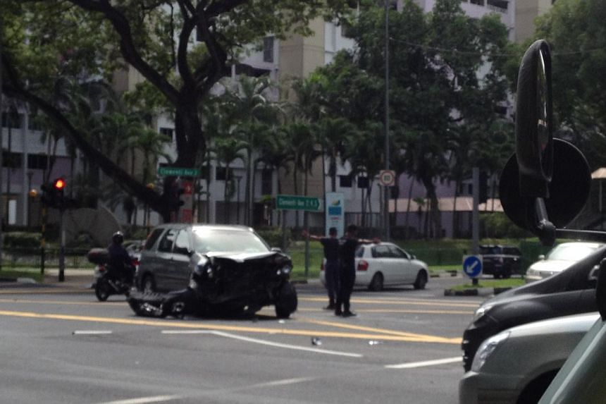 Two cars crashed on Tuesday afternoon at a Clementi Road junction, with one flying across a divider and hitting a third car on a slip road. -- ST PHOTO: JOANNA SEOW