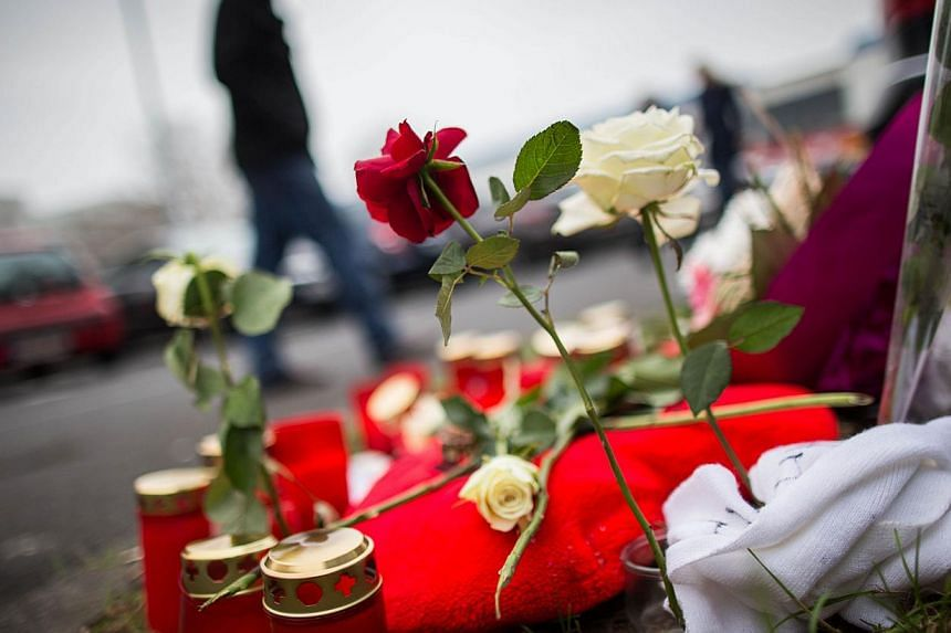 Flowers and candles left on Dec 1 at the scene where student Tugce Albayrak was beaten up after coming to the aid of two girls who were being harassed in Offenbach, central Germany, on Nov 14. Miss Albayrak died on Nov 28.