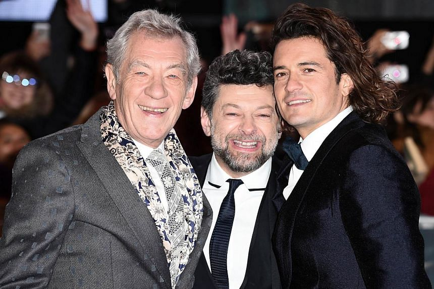 English actors (from left) Ian McKellen, Andy Serkis and Orlando Bloom pose for pictures on the red carpet upon arrival for the world premiere of The Hobbit: The Battle Of The Five Armies in central London on Dec 1, 2014. -- PHOTO: AFP