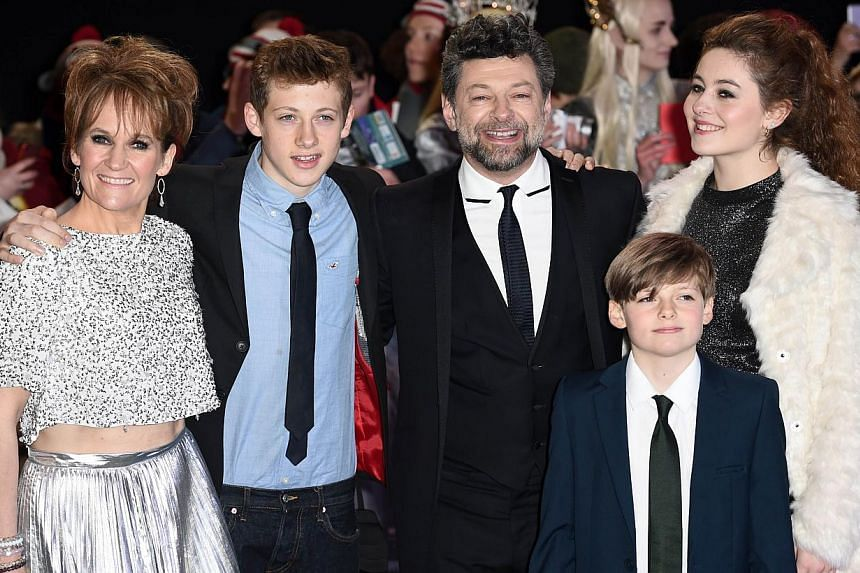 English actor Andy Serkis poses for pictures on the red carpet with his wife Lorraine Ashbourne (left) and their children Ruby (right) Sonny (second from left) and Louis upon arrival for the world premiere of The Hobbit: The Battle Of The Five Armies