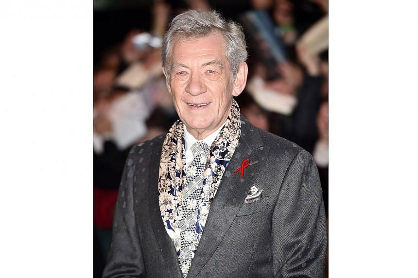 English actor Ian McKellen poses for pictures on the red carpet upon arrival for the world premiere of The Hobbit: The Battle Of The Five Armies in central London on Dec 1, 2014. -- PHOTO: AFP