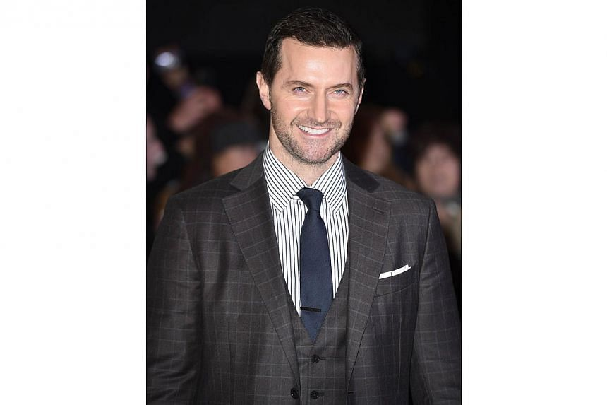English actor Richard Armitage poses for pictures on the red carpet upon arrival for the world premier of The Hobbit: The Battle Of The Five Armies in central London on Dec 1, 2014. -- PHOTO: AFP