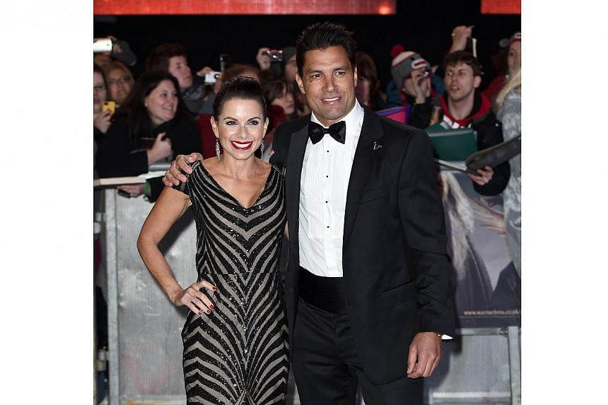 Australian-New Zealand actor Manu Bennet and his wife, Karin Horen, posing for pictures on the red carpet upon arrival for the world premiere of The Hobbit: The Battle Of The Five Armies in central London on Dec 1, 2014. -- PHOTO: AFP