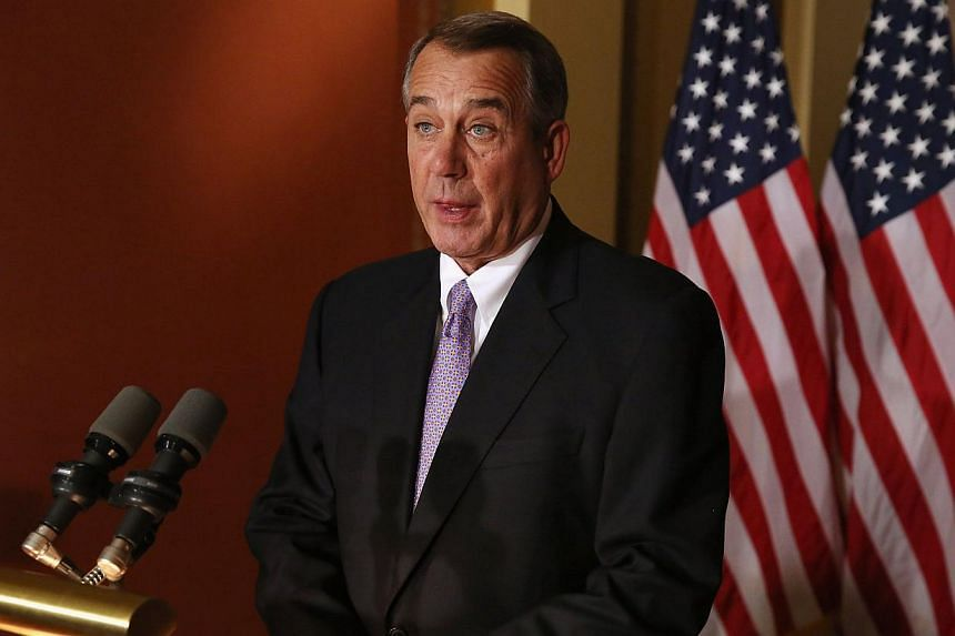 US House of Representatives Speaker John Boehner's government spending bill will avoid a shutdown fight but allows Republicans to strike back at President Barack Obama's immigration order. -- PHOTO: AFP