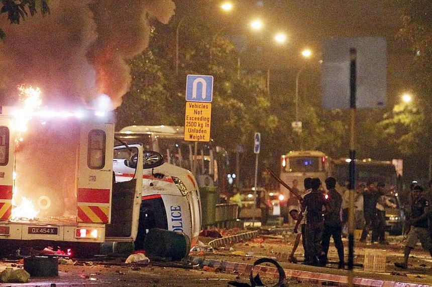 An ambulance burns after a riot that broke out along Race Course Road in Little India riot on Dec 8, 2013. A construction worker was sentenced to a year in prison on Tuesday, for assaulting a police officer during the Little India riot last year. --