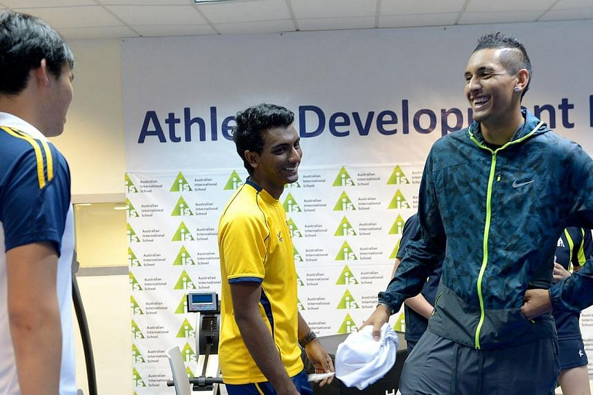 Australian tennis player Nick Kyrgios met students from the Australian International School (AIS) on Tuesday, sharing stories from his journey so far with some of the school's top athletes. -- ST PHOTO: JAMIE KOH