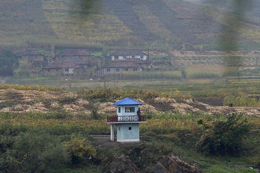 North Korean soldiers stand guard at a sentry on the Yalu River near the North Korean city of Hyesan, Ryanggang province, opposite the Chinese border city of Linjiang. A retired People's Liberation Army general said China will not step in to save the