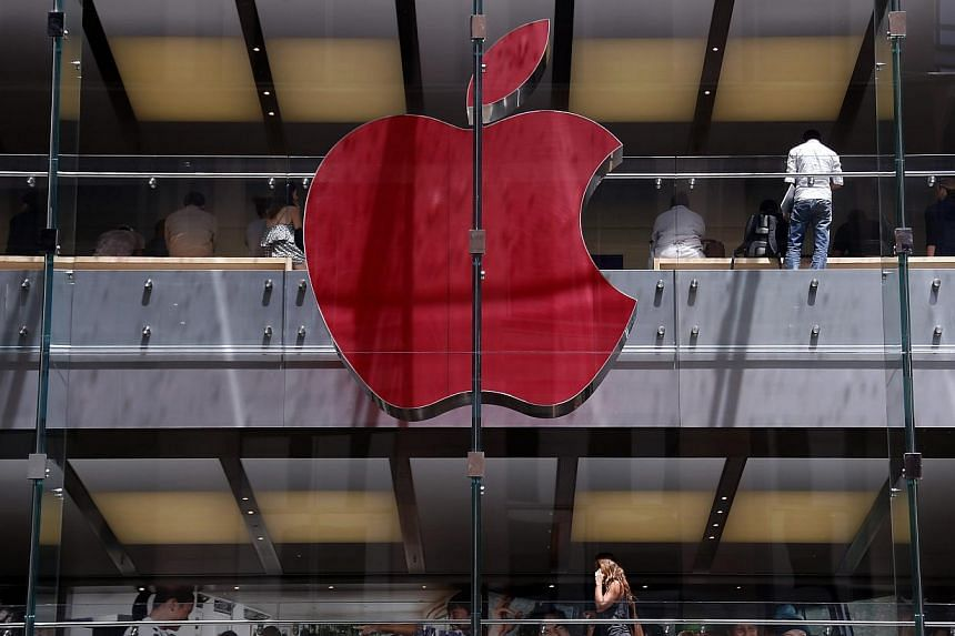 The Apple logo on display at the Sydney Apple Store is illuminated in red to mark World AIDS Day, in Sydney on Monday. Apple stores across the world will display similar colored logos, with the Sydney store being the first. World AIDS Day is observed