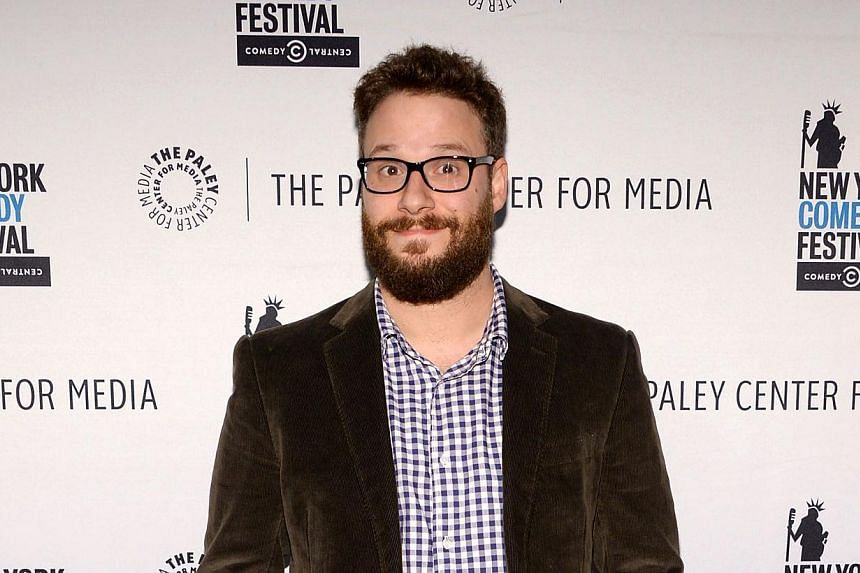Actor Seth Rogen attends a panel discussion in New York City on Nov 9. Rogen stars in a satire called The Interview, about a plot to kill North Korean leader Kim Jong Un, to be released by Sony Pictures which has seen several of its movies hacked and