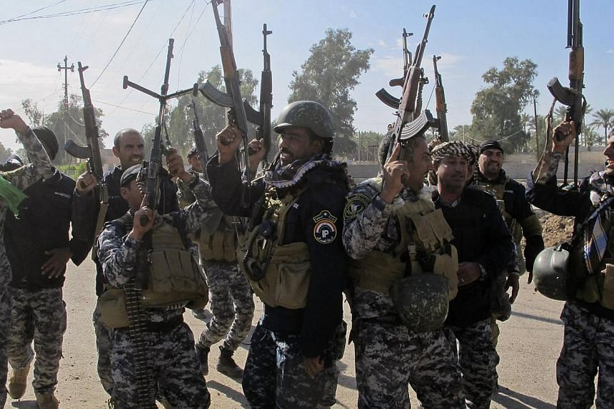 Iraq's government and the autonomous Kurdish region have reached an agreement resolving a longstanding dispute over the budget and oil, in a move seen as a key step in improving cooperation against extremists. -- PHOTO: REUTERS
