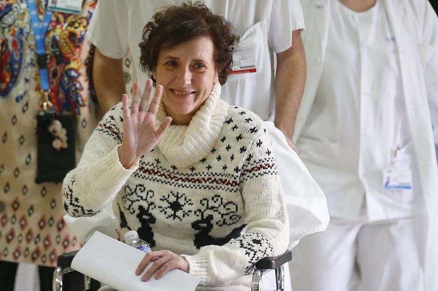 Spanish nurse Teresa Romero, who contracted Ebola, smiles after being discharged from hospital in Madrid on Nov 5, 2014. The World Health Organisation on Tuesday declared Spain free of Ebola after going a month and a half with no new cases since